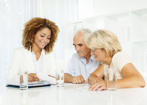 Senior couple meeting with financial advisor and talking about insurance and retirement options. [url=http://www.istockphoto.com/search/lightbox/12236511][img]http://www.photoama.com/seniors-photoama.jpg[/img][/url]