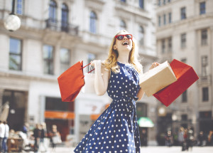 Beautiful, blonde woman is shopping in the city